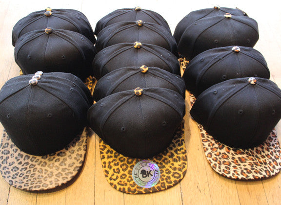 Wholesale lot of 15 Various Black/ Cheetah Snapbacks