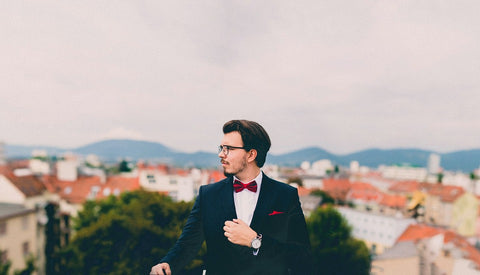 Man in Black Suit and Red Bowtie