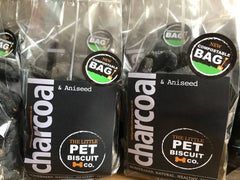 Charcoal dog biscuits in a compostable bag