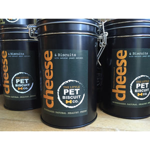 A treat tin filled with cheese flavoured dog biscuits from The Little Pet Biscuit Company