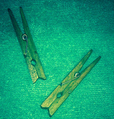 Dyed green clothespins