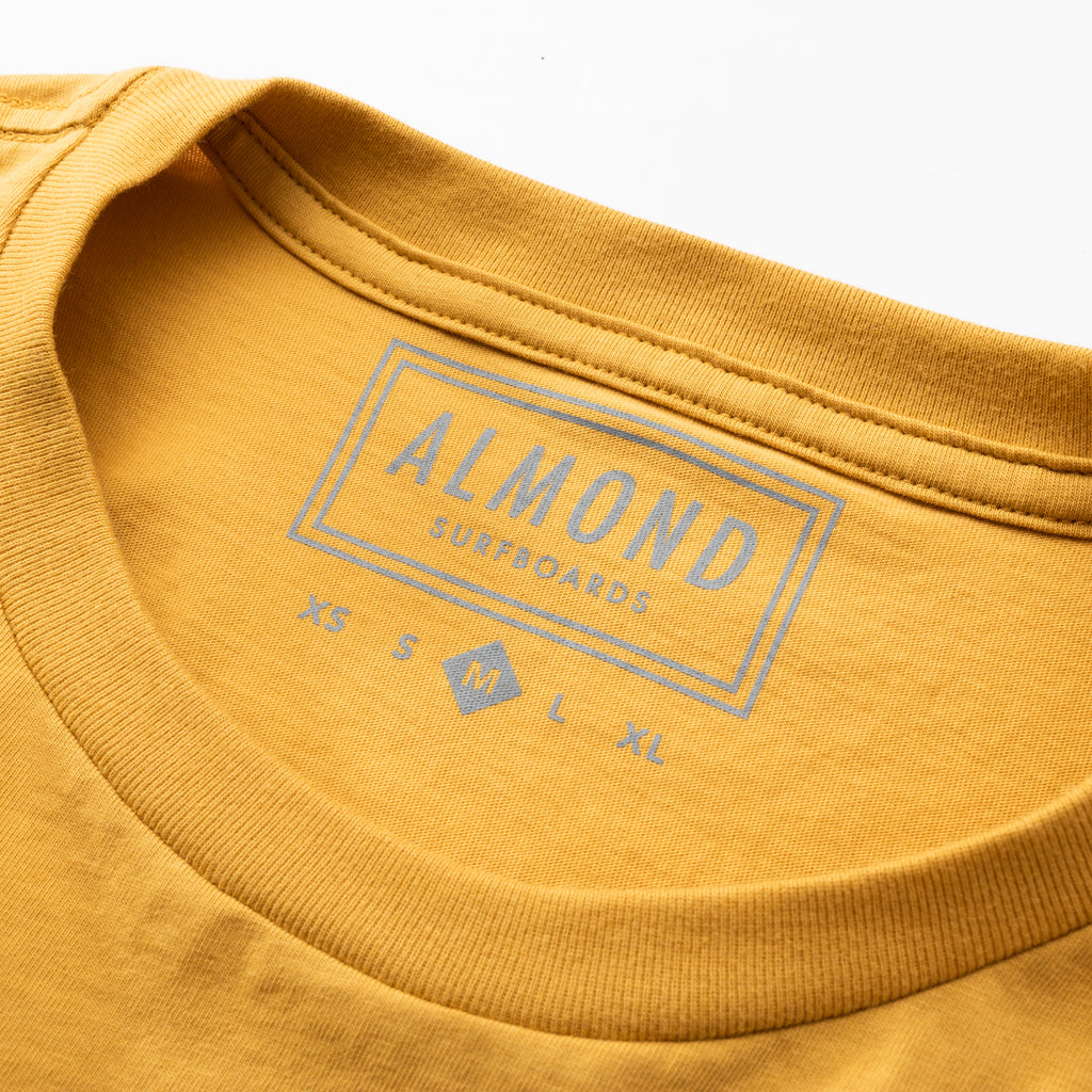 Wave Badge Pocket Tee | Mustard