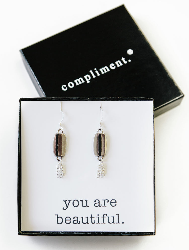 silver lining earrings.
