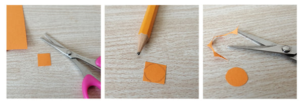 Orange paper with a small circle drawn on it. A pair of scissors and orange circle cutout.