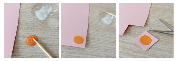Glue and a tooth pick. Orange circle of paper glued to a piece of pink paper.