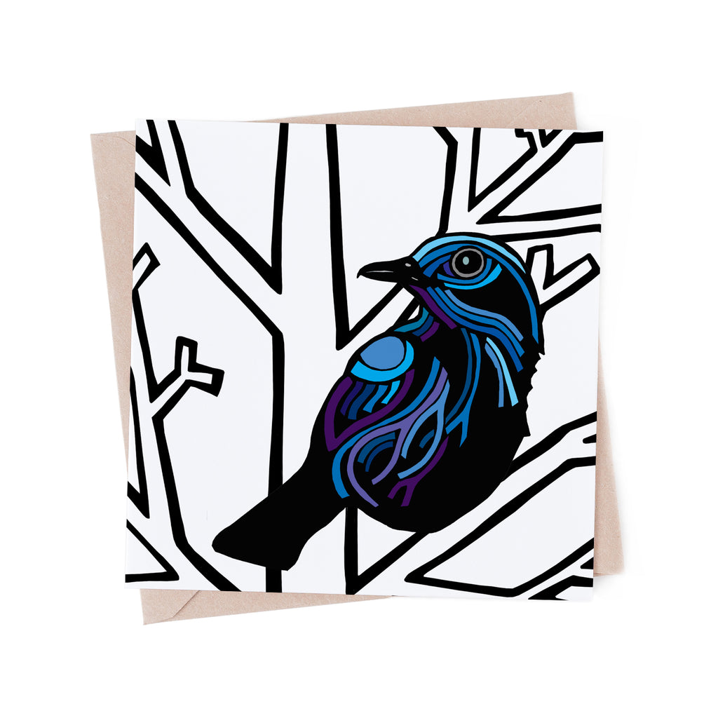 Square greeting card with a blue, stylized bird perched in a bare, white, winter tree. Brown envelope in the background