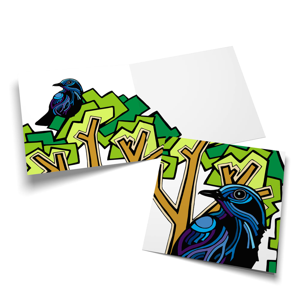 Inside of a square greeting card with a green tree on the left side. There is a blue, stylized bird perched in the tree.
