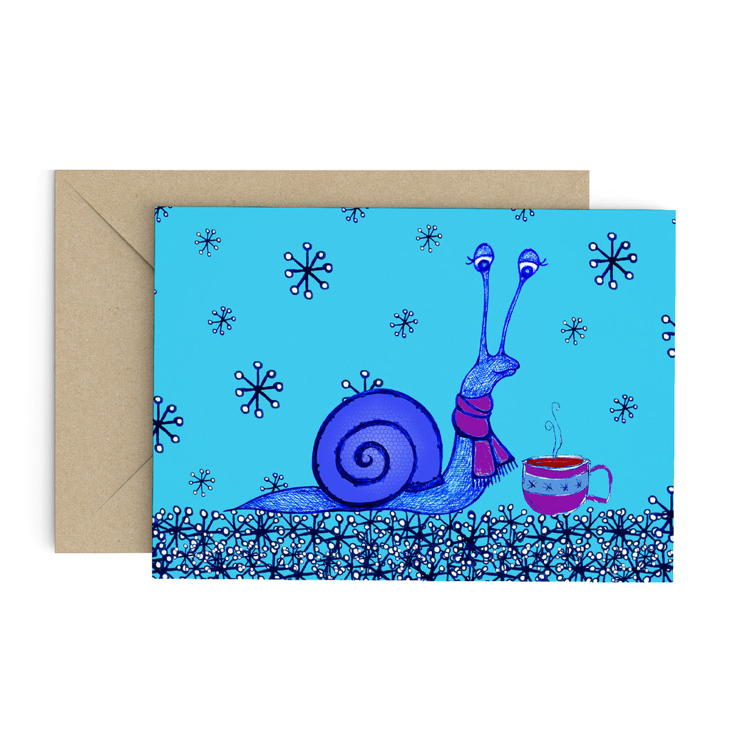 Blue snail in a purple scarf, enjoy a hot tea on a blue card full of snow flakes. A brown envelope is in the background.