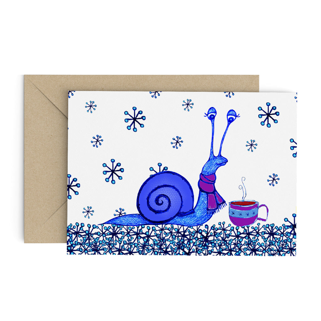 Blue snail in a purple scarf, enjoy a hot tea on a greeting card full of snow flakes. A brown envelope is in the background.