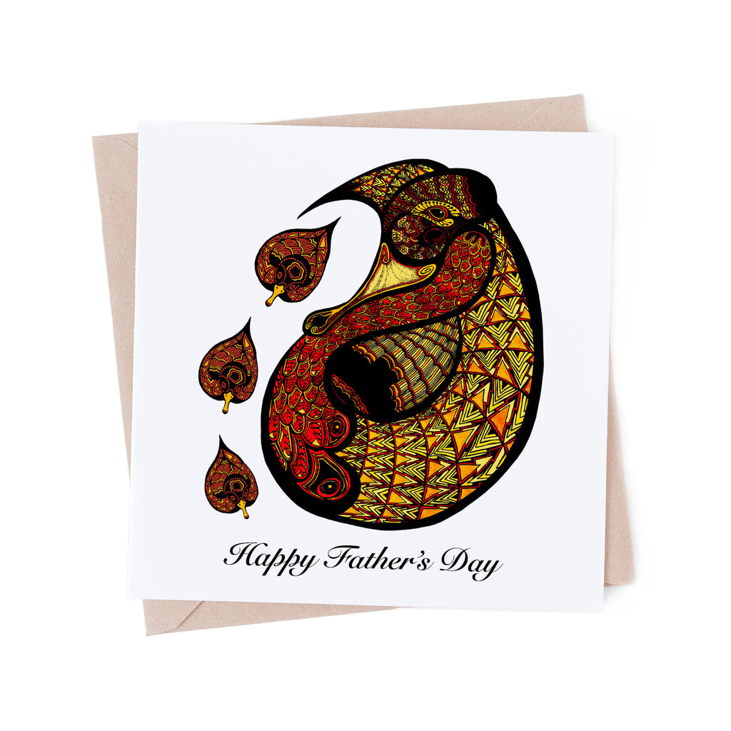 Stylized, red and yellow father duck with three ducklings on a white greeting card. A brown envelope is in the background.