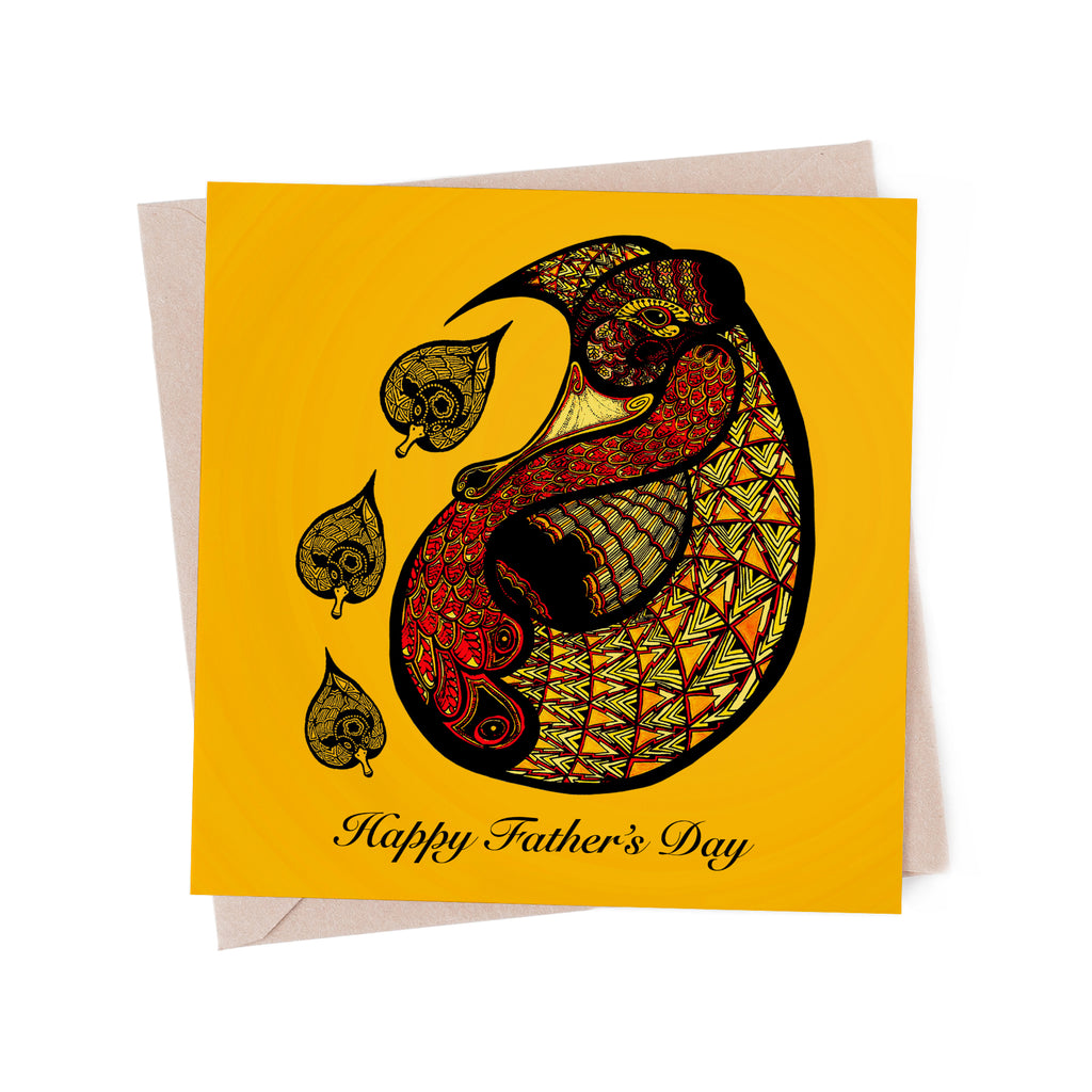 Stylized, red and yellow father duck with three ducklings on a yellow greeting card. A brown envelope is in the background.