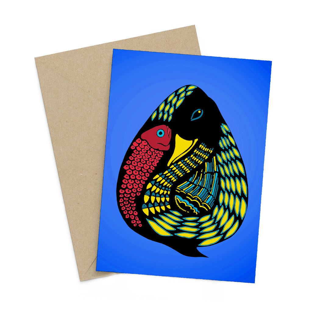 Stylized, blue and yellow duck with a red fish on a blue greeting card. A brown envelope is in the background.
