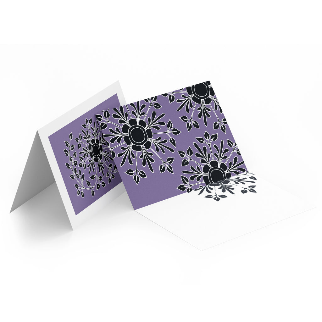 White inside of a landscape style greeting card. Top half of the card has black folk flowers on a purple background.