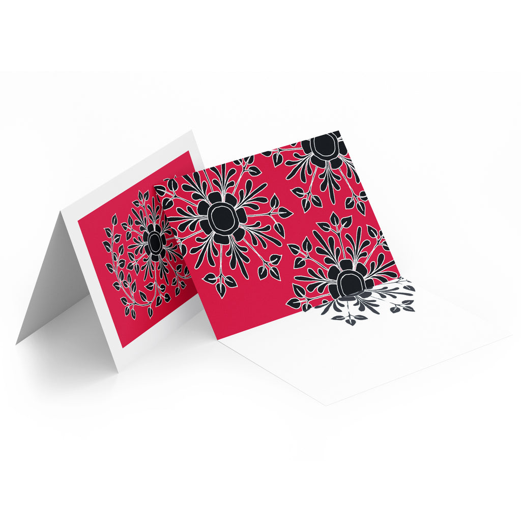 White inside of a landscape style greeting card. Top half of the card has black folk flowers on a red background.