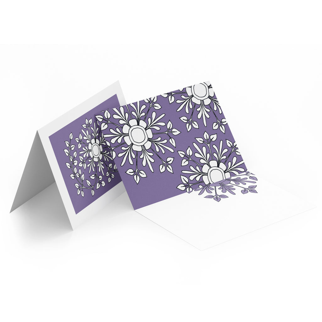 White inside of a landscape style greeting card. Top half of the card has white folk flowers on a purple background.