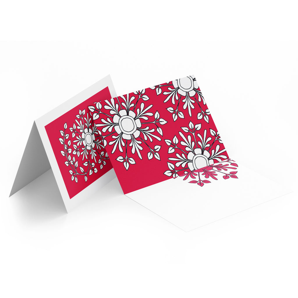 White inside of a landscape style greeting card. Top half of the card has white folk flowers on a red background.