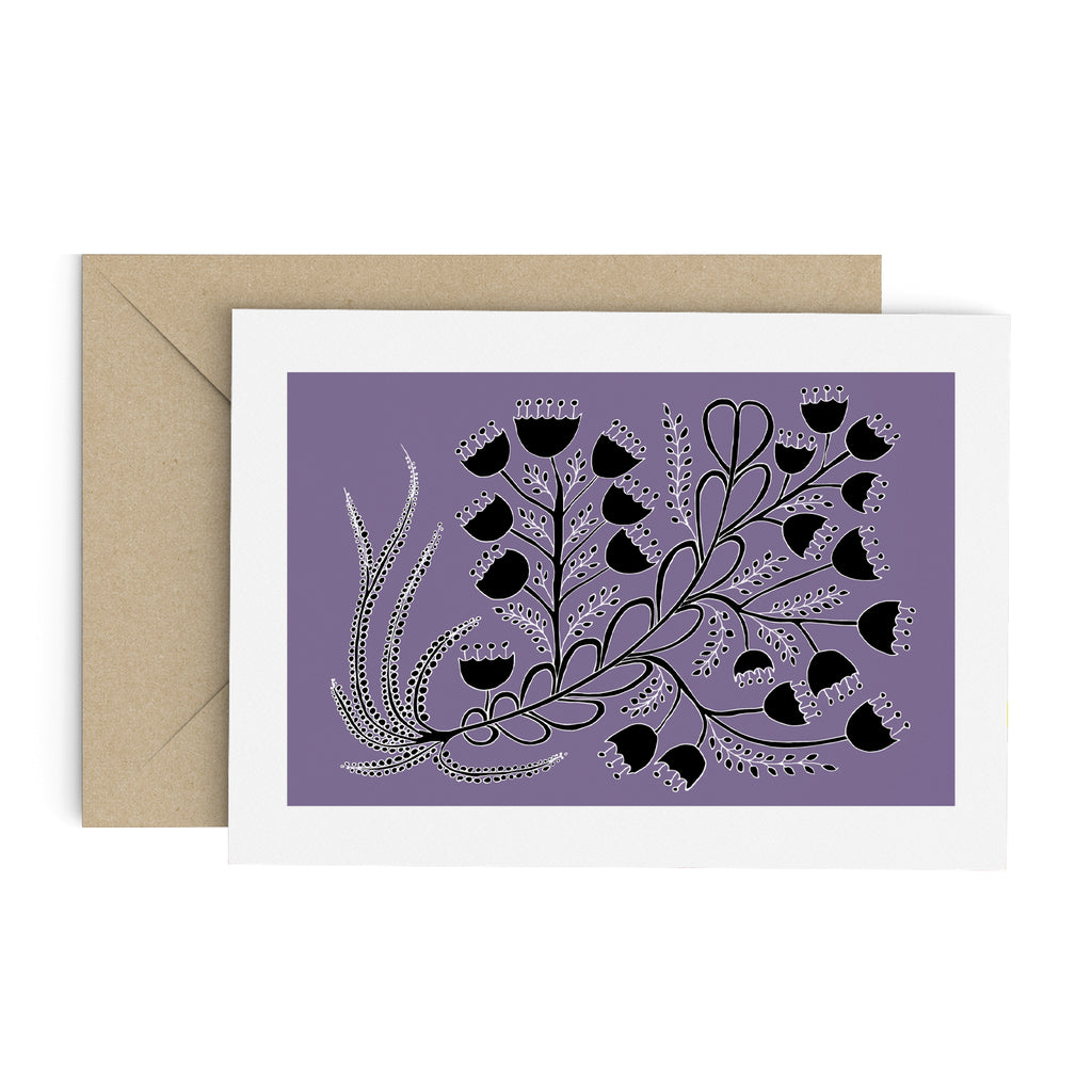 Black bell flower bouquet drawing on a purple greeting card with a white border. A brown envelope is in the background.