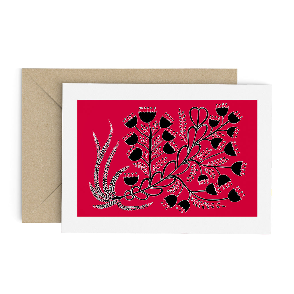 Black bell flower bouquet drawing on a red greeting card with a white border. A brown envelope is in the background.
