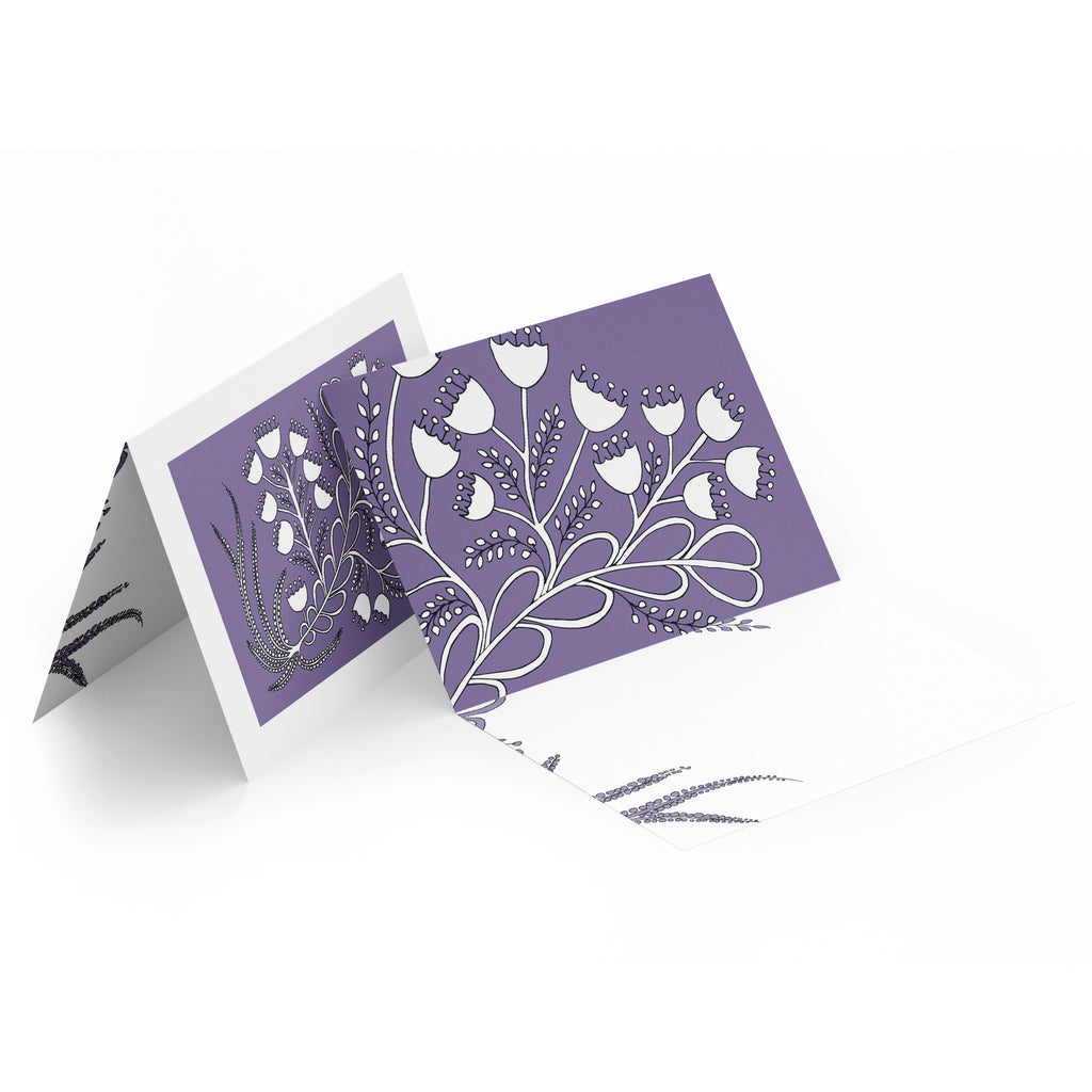 White inside of a landscape style greeting card. Top half of the card has white bell flowers on a purple background.