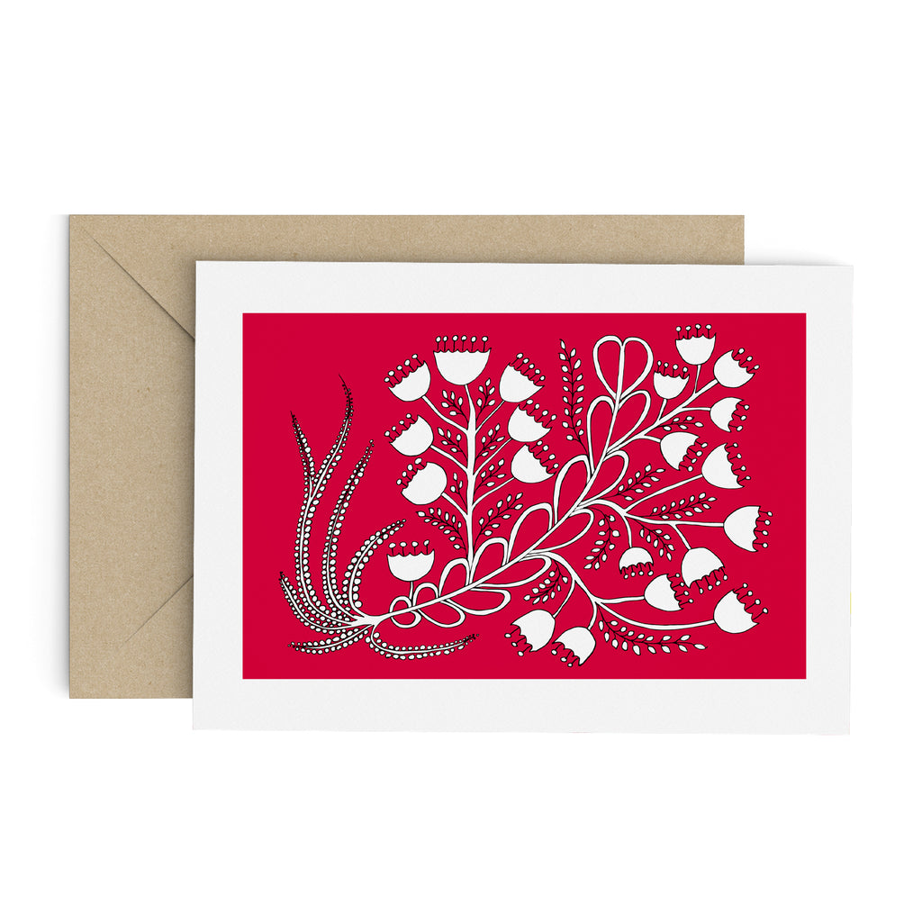 White bell flower bouquet drawing on a red greeting card with a white border. A brown envelope is in the background.
