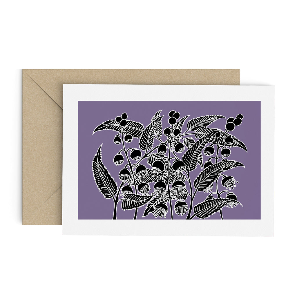 Drawing of a black bell flower bush on a purple greeting card with a white border. A brown envelope is in the background.