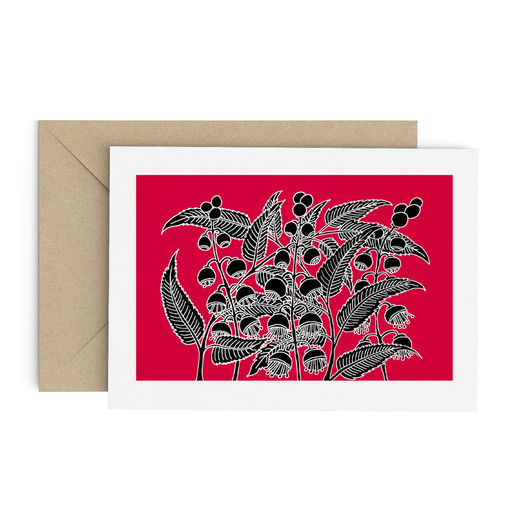 Drawing of a black bell flower bush on a red greeting card with a white border. A brown envelope is in the background.
