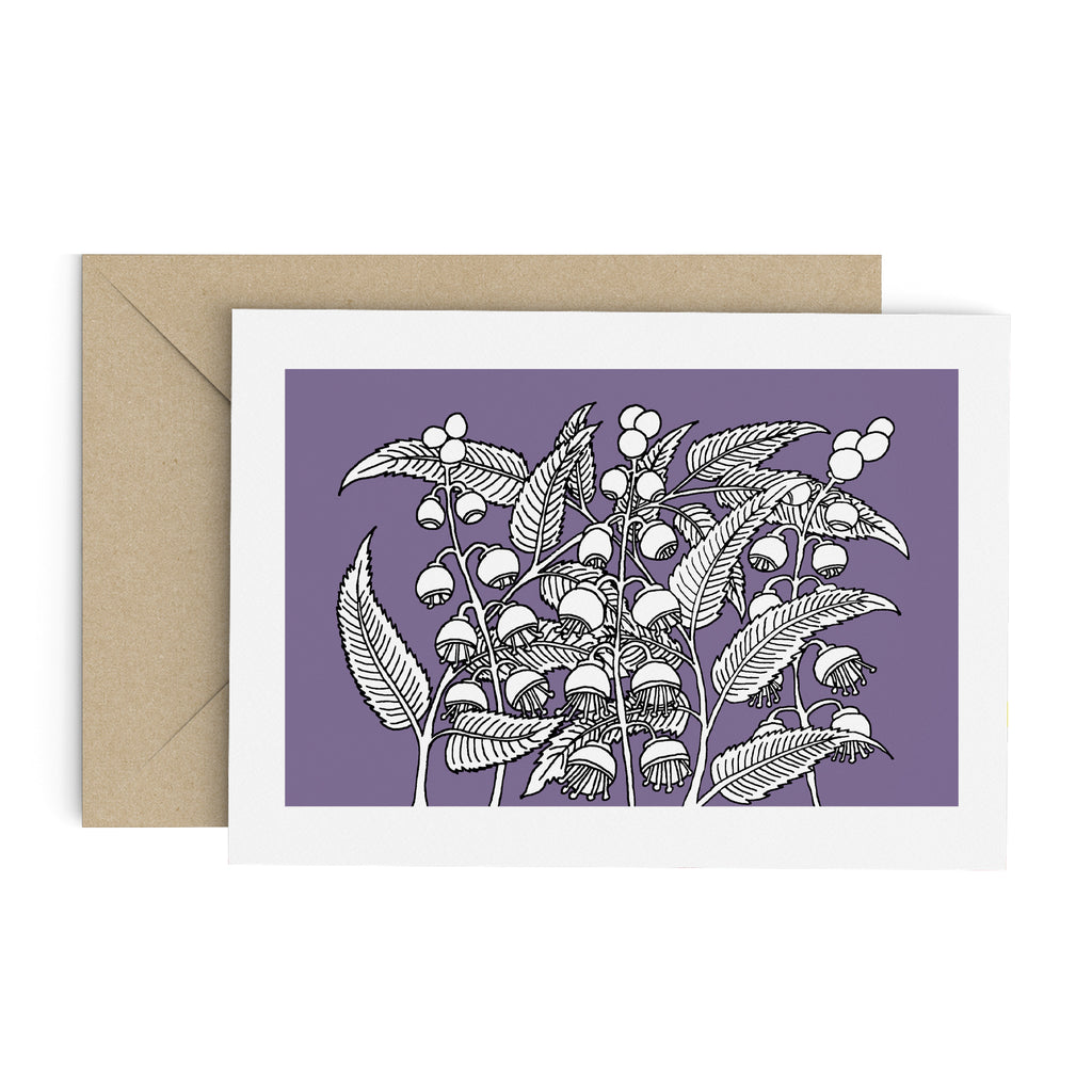 Drawing of a white bell flower bush on a purple greeting card with a white border. A brown envelope is in the background.