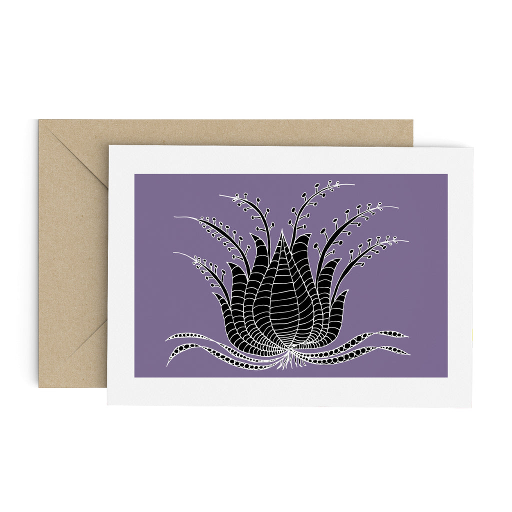 Drawing of a black succulent-like plant on a purple greeting card with a white border. A brown envelope is in the background.