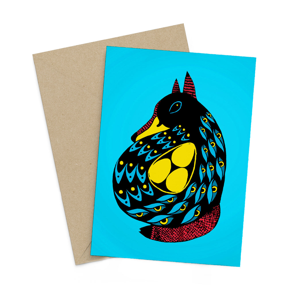 Stylized, duck with fox ears and tail, carrying three eggs on a blue greeting card. A brown envelope is in the background.