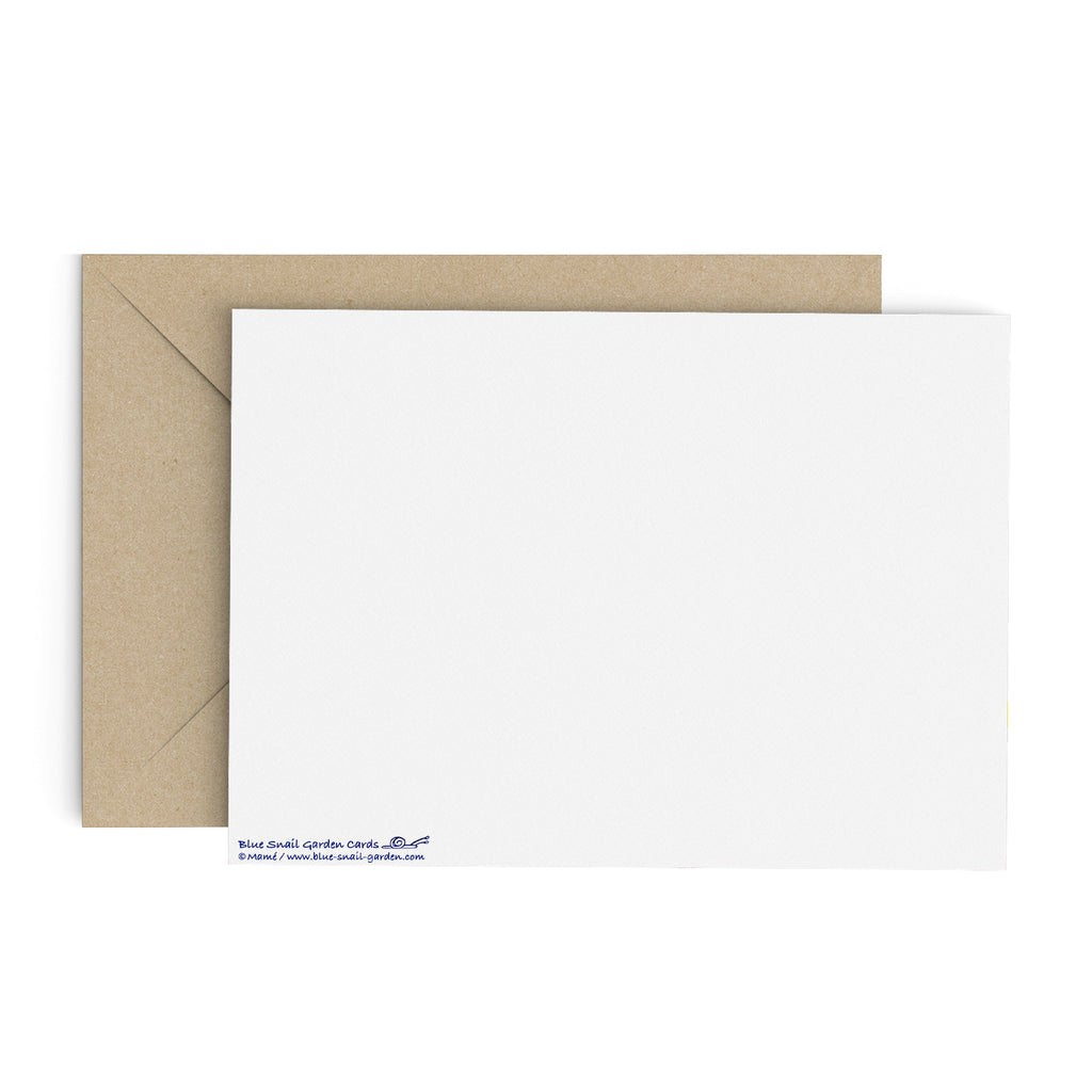 Back of a landscape style, white greeting card with a brown envelope in the background. Copyright Mamé.
