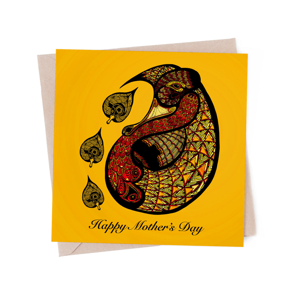 Stylized, red and yellow mother duck with three ducklings on a yellow greeting card. A brown envelope is in the background.