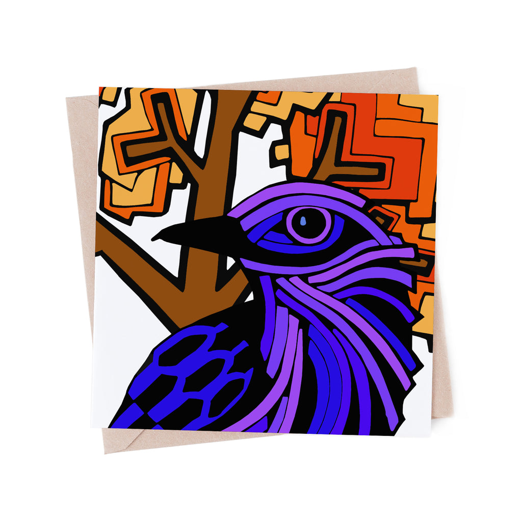 Square greeting card with a stylized, purple bird with an orange tree. There is a brown envelope in the background.