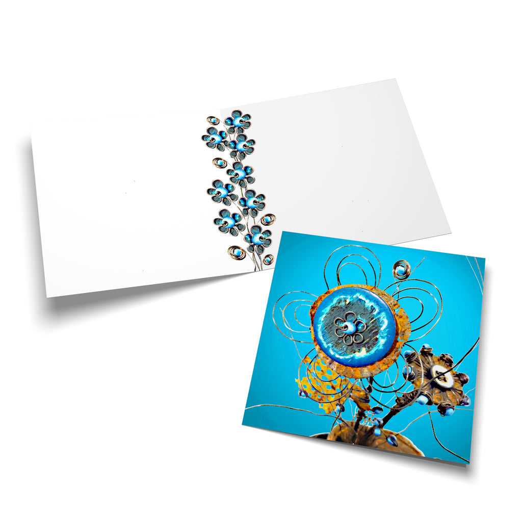 White inside of a square greeting card. Blue wire spirals and flowers grow up the spine of the card.