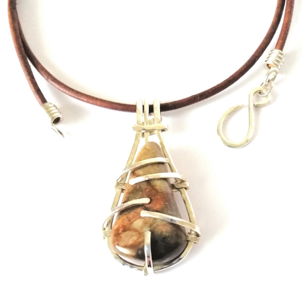 Drop shaped ocean jasper and silver pendant. Deep red and green marble effect. Brown leather cord necklace with silver hook