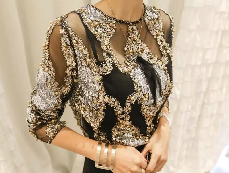 Sexy, Sheer Heavy Beaded shirt..