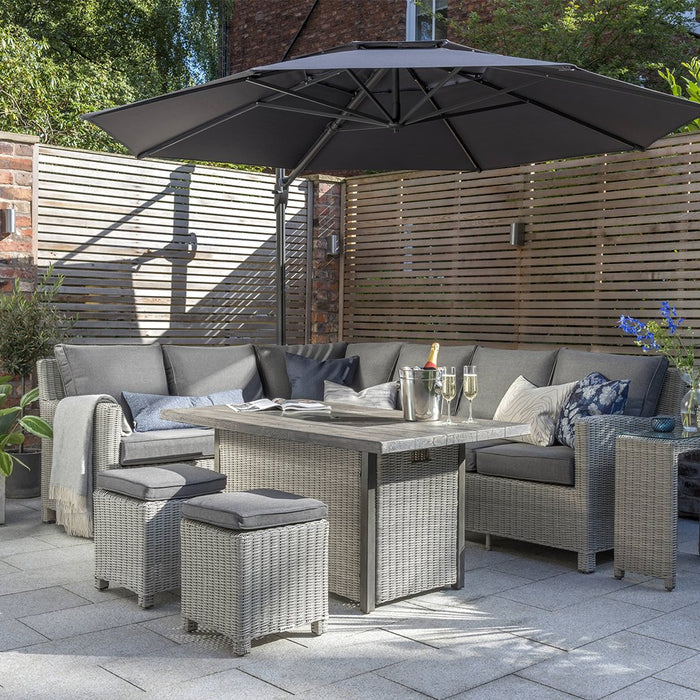 Kettler Palma Rattan Corner Sofa Set, Right-Hand in White Wash With Height Adjustable Table in Situ - Mid Ulster Garden Centre, Ireland