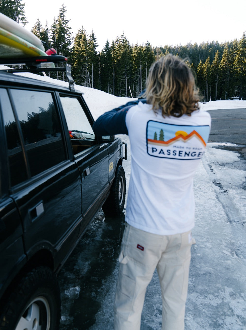 Brandon Haley stands next to his 4x4 wearing a passenger L/S t-shirt