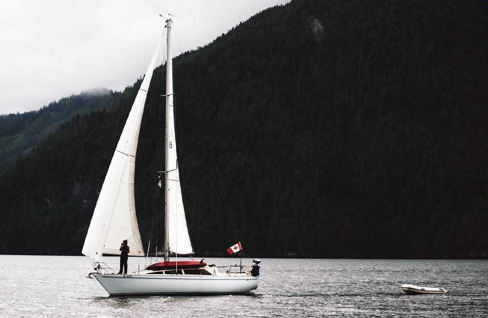 A sail boat waits anshored in a Canadian lake