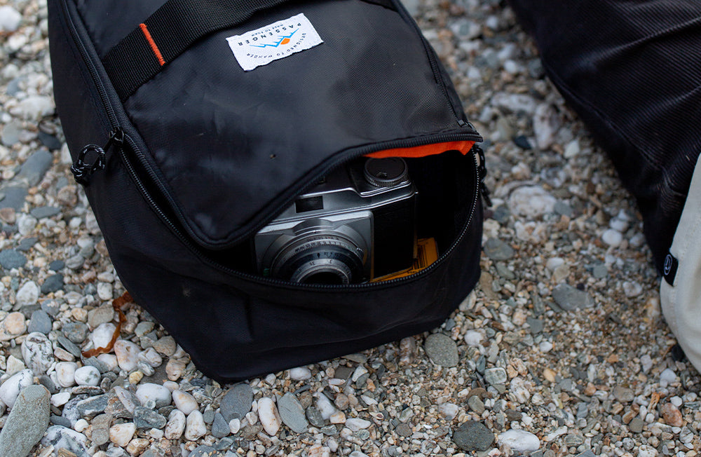 A camera sits inside a Passenger Packing Cube