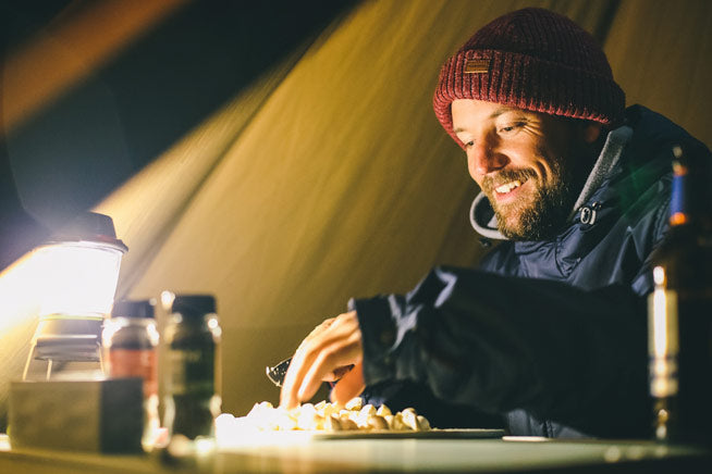 Barry Mottershead cooking in the tipi
