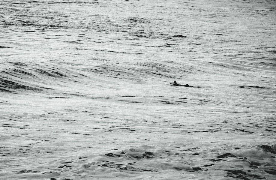 Winter in England lone surfer
