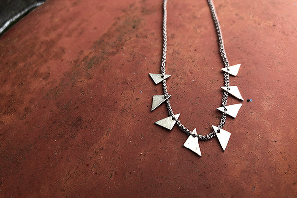 The Good Supply n Pemaquid Maine Textile Artist Erica Schlueter of Bent Metal Crocheted Silk Thread and Sterling Silver Jewelry Triangle Shards Necklace Made in USA