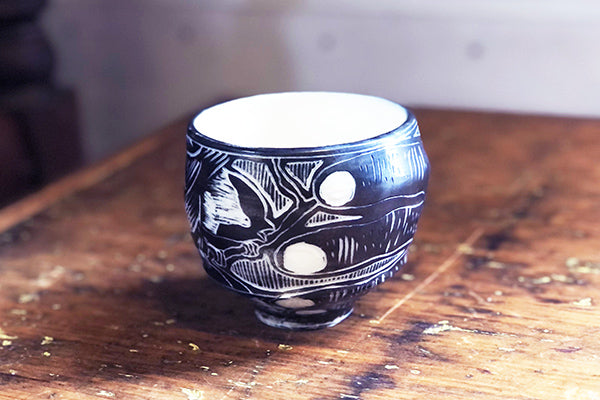 The Good Supply Pemaquid Maine Environmental Artist Tim Christensen Ceramic Sculpture Sgraffito Cup Here's to You with hand and Chickadee Made in USA