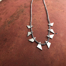 The Good Supply in Pemaquid Maine Textile Artist Erica Schlueter of Bent Metal Crocheted Shile Thread and Sterling Silver Jewelry Triangle Shards Necklace in Gray Made in USA