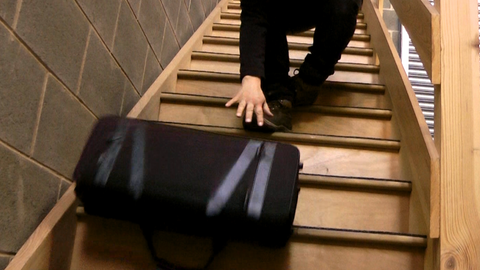 Bag falling down the stairs