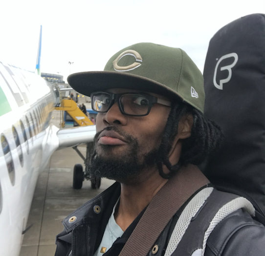 Is Josiah Woodson going to get on the plane with his guitar bag?
