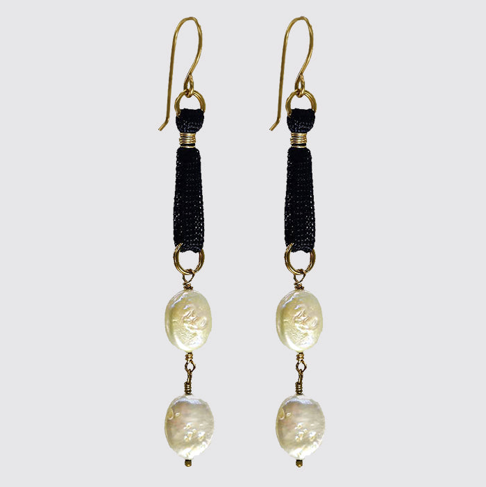 White Freshwater Pearls On A Black Silk Cord