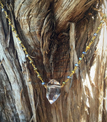 Tibetan Quartz point on golden pyrite chain