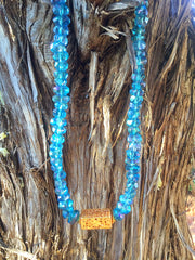 Aqua aura andTibetan gold necklace