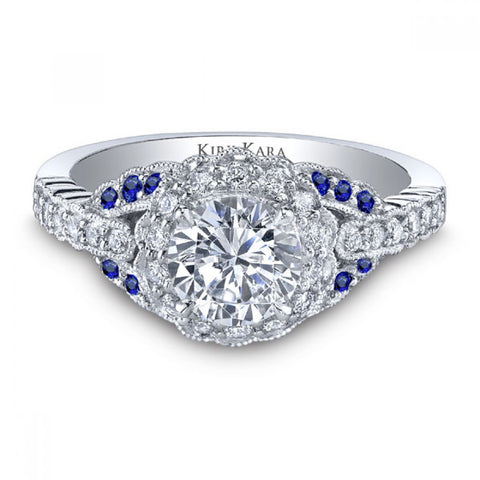 Kirk Kara Pirouetta Halo Diamond Engagement Ring Featuring 0.35 Carats of Diamonds and 0.17 Carats Sapphires set in 18kt White Gold. Style  SS6954S-R